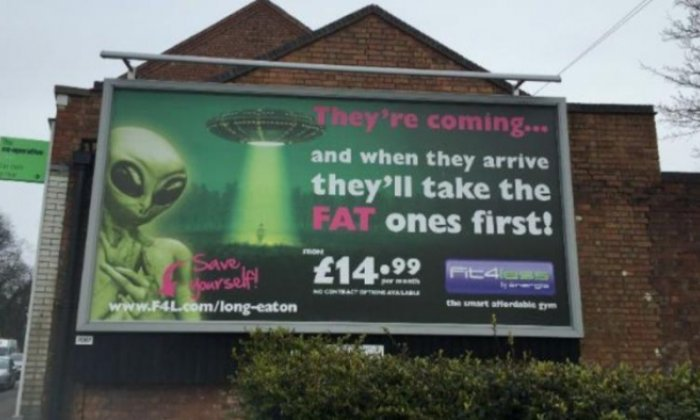 Gym billboard sparks bullying debate with claim aliens will 'take the fat ones first'