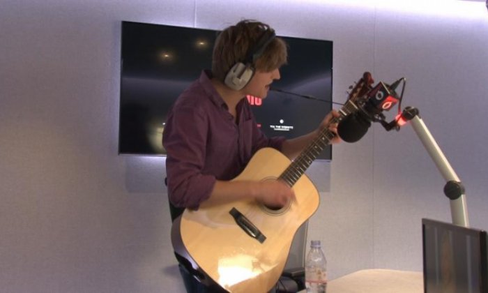 WATCH: Jon Holmes invites busker Charlie Law to perform live on air