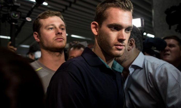 The US Olympic Committee apologises for behaviour of American swimmers