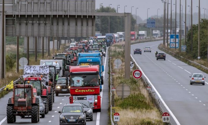 Lorries and tractors fill the road
