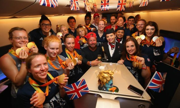 The team celebrate together on their flight (Getty)