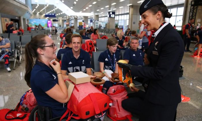 Medal winners celebrate with staff at the airport (Getty)