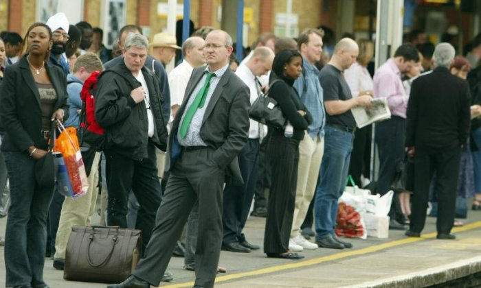 Commuters wait for a train at Clapham Junction