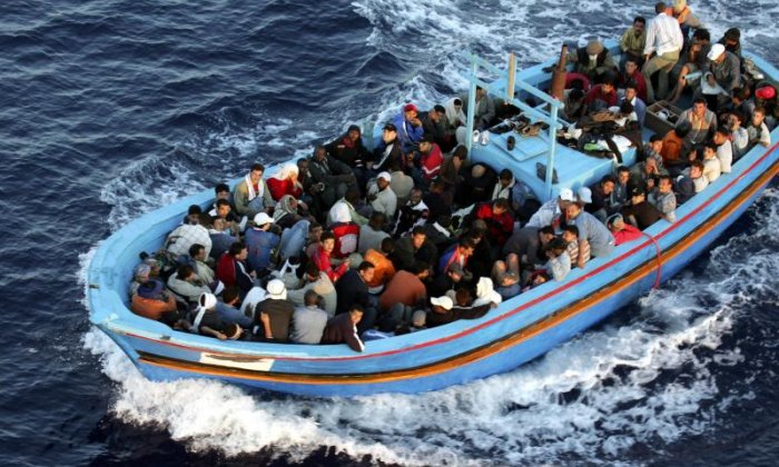 Armed men attack a migrant boat of the coast of Libya
