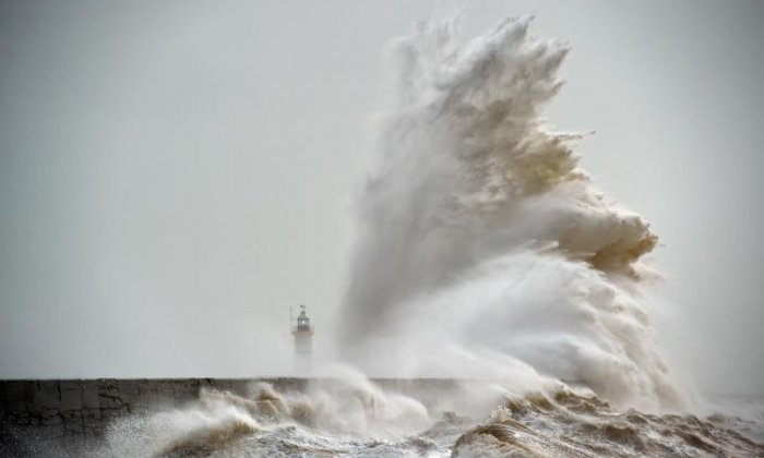 Flood warning in place for east coast as rain, wind and snow batter the UK