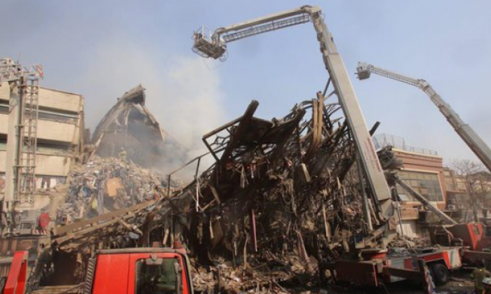30 firefighters die after high-rise building collapses in Tehran