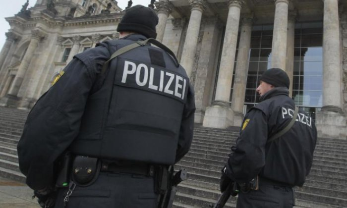 Police arrest Tunisian man on suspicion of planning a terror attack, after raiding homes, mosques and businesses