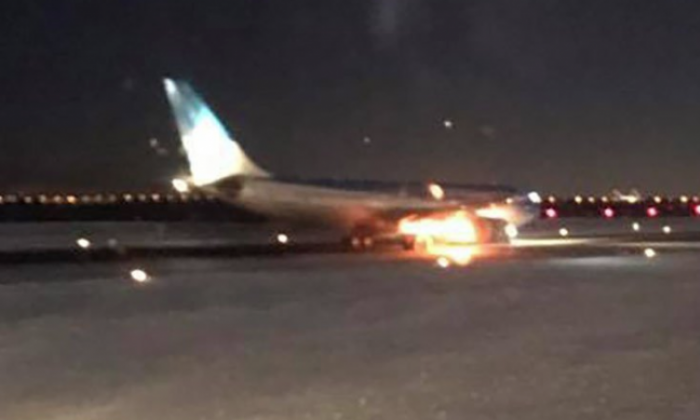 Aerolineas Argentinas plane catches fire on the runway at New York's JFK airport
