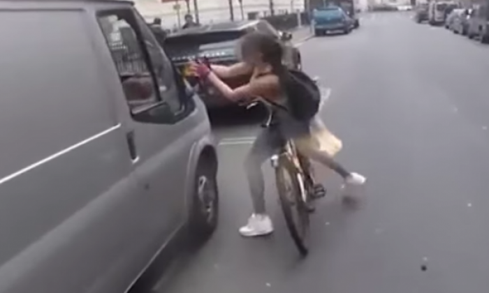 Workman's catcalls provoke female cyclist to rip van mirror off in Go-Pro road rage footage in London