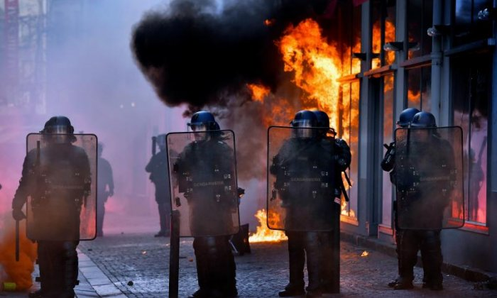 French elections: Riots in Paris after Marine Le Pen advances to second round