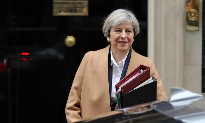 Theresa May suggests freedom of movement could be temporarily extended for post-Brexit 'implementation period'
