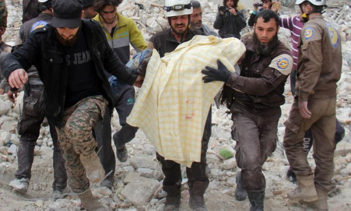 Members of the White Helmets rescue forces remove a body after the bombardment of Idlib in March 2017. The city has suffered another horrific bombardment this week