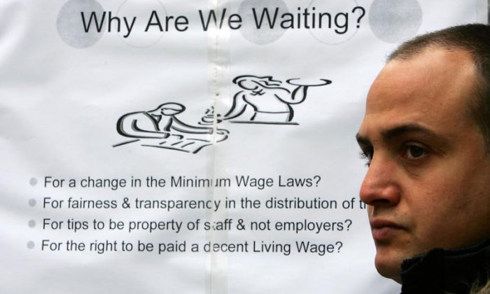 A campaigner seen during a protest for the establishment of a living wage in London