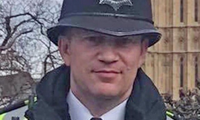 West Yorkshire Police stand silent for PC Keith Palmer