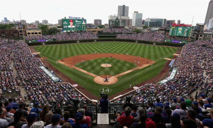 Man dies after falling over railing at baseball stadium in Chicago