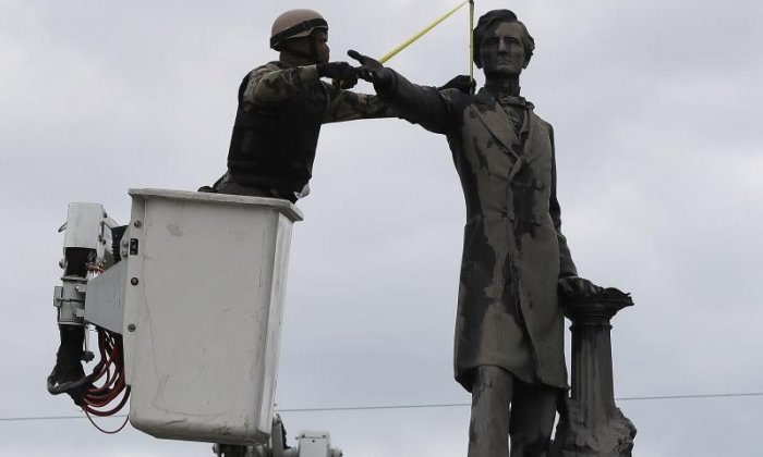 Work crews guarded by police as they remove statue of Confederate President Jefferson Davis in New Orleans