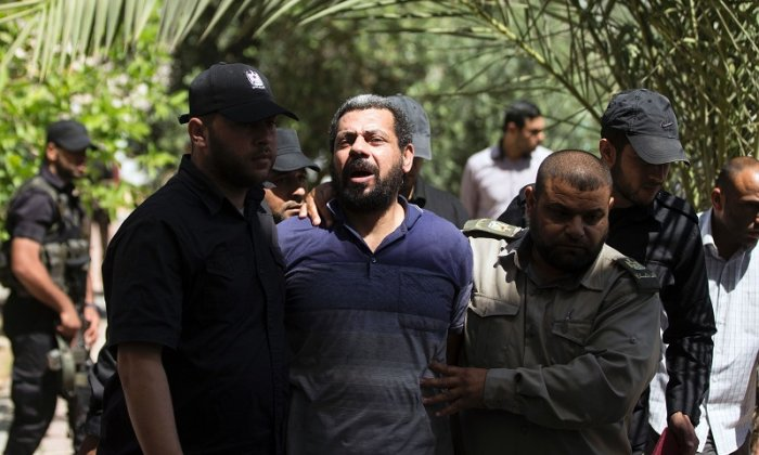 One of the men, Hisham A, is seen during the trial