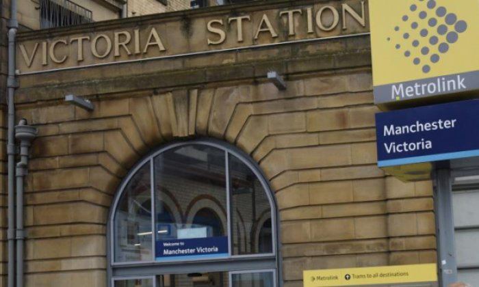 Woman in custody after man pushed in front of moving tram in Manchester dies