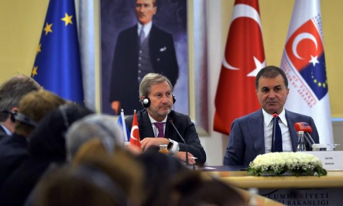 European Commissioner for Enlargement Johannes Hahn (L) and Turkish EU Affairs Minister Omer Celik (R) attend a meeting to discuss Turkey's European Union membership bid on July 6, 2017, in Ankara