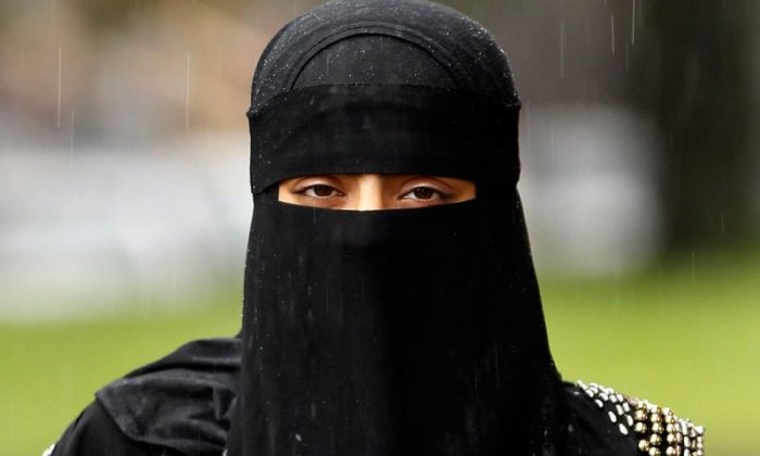Muslim mother takes legal action after being asked by school to leave through back door for wearing face veil