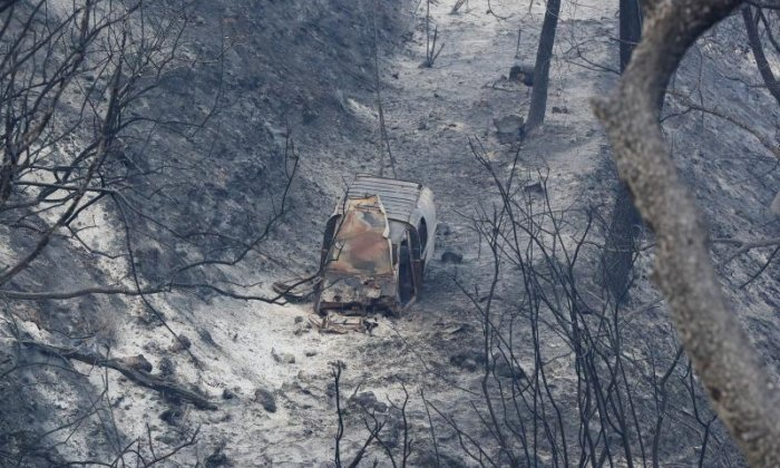 A vehicle is seen ruined by the fire in Carros near Nice