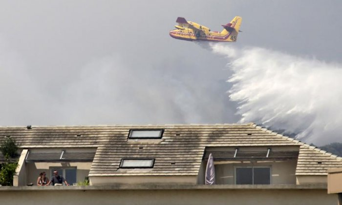 Planes were used to drop water over the fire