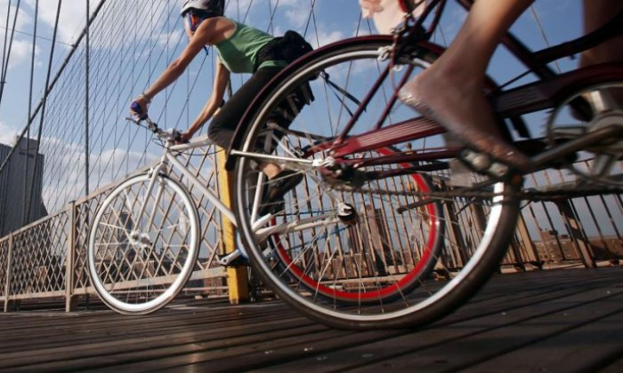 Cyclist hit by bus after bike wheels become stuck in tram tracks