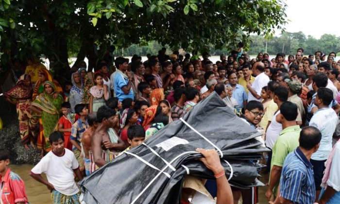 Victims of the flood queue for relief materials