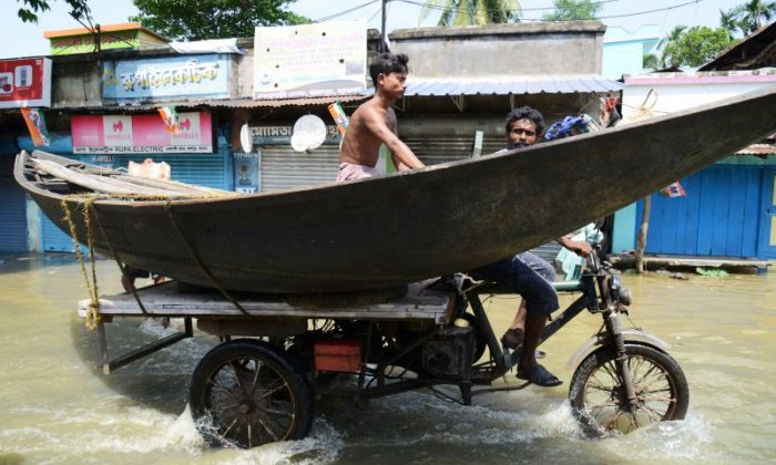 A boat is transported to help people in the village of Shehagori