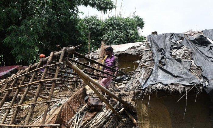 People collect their belongings from ruined homes in the Rautahat District, Nepal