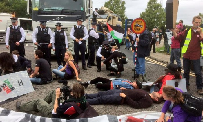 Police are seen at the event as a British Palestinian talks to the crowd (Credit: London Palestine Action)