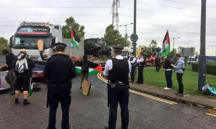 Protestors stand in front of vehicles trying to bring supplies to the event (Credit: London Palestine Action)