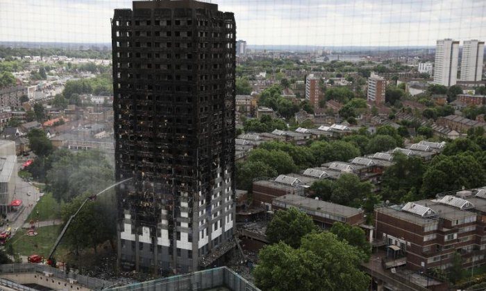 'Not a tourist attraction' Ghoulish Chinese tourists condemned over Grenfell Tower visit