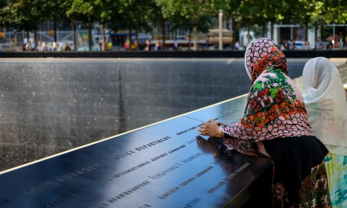A woman regards the memorial
