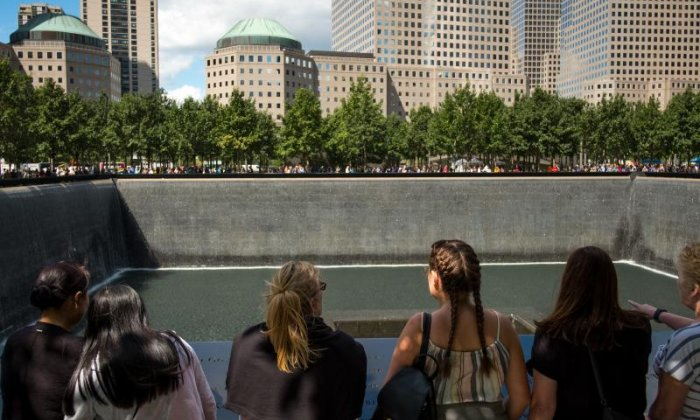 Spectators gather at the 9/11 memorial ahead of the anniversary