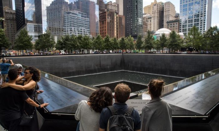 Spectators gather at the site of the 9/11 memorial
