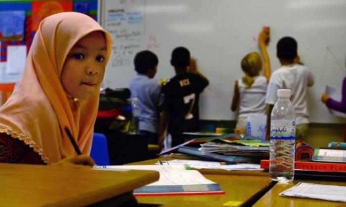 The wearing of hijabs in schools is subject to an ongoing debate (stock photo)