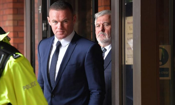 Wayne Rooney leaves court after his sentencing yesterday (September 19)