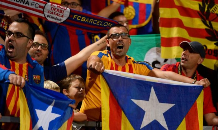 Catalan fans hold up independence flags during the recent derby between Girona and Barcelona
