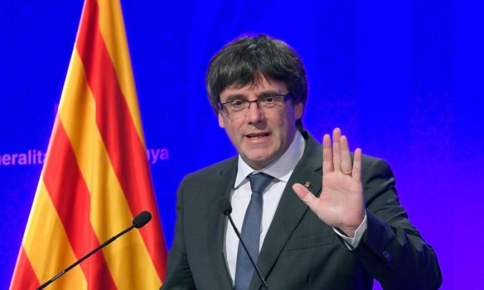 Catalonia independence declaration is signed and temporarily suspended
