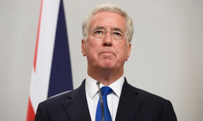 Sir Michael Fallon has apologised for touching Julia Hartley-Brewer's knee in 2002