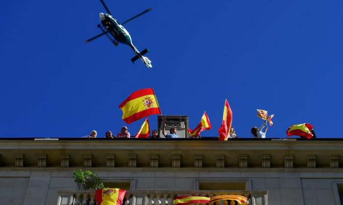 A helicopter is seen above those taking part
