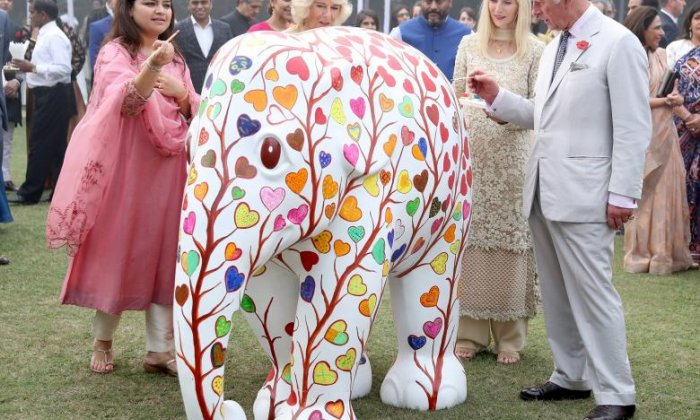 Prince Charles paints an elephant sculpture in New Delhi, India