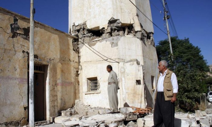 A damaged building is inspected