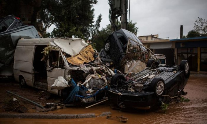 Damaged vehicles are piled on streets