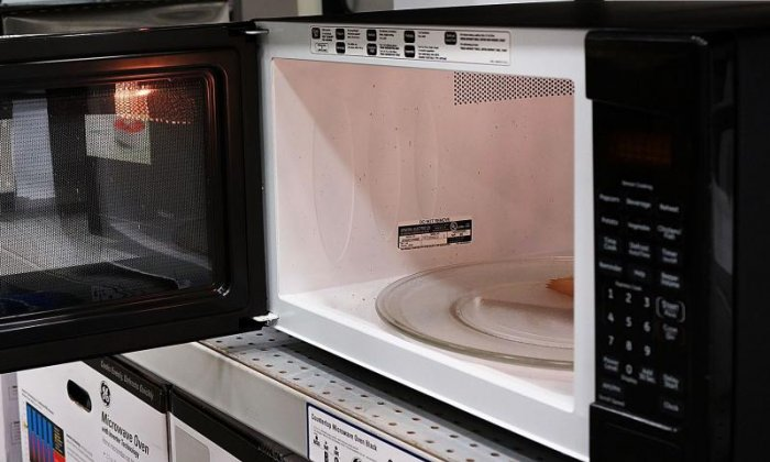 Firefighters rescue British man who cemented head inside a microwave
