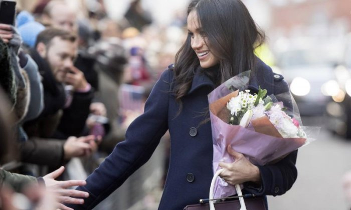 Meghan Markle is seen with flowers