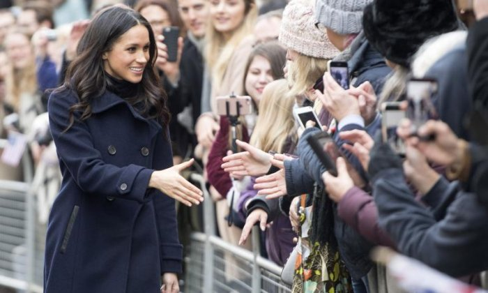 Meghan Markle shakes hands with members of the crowd