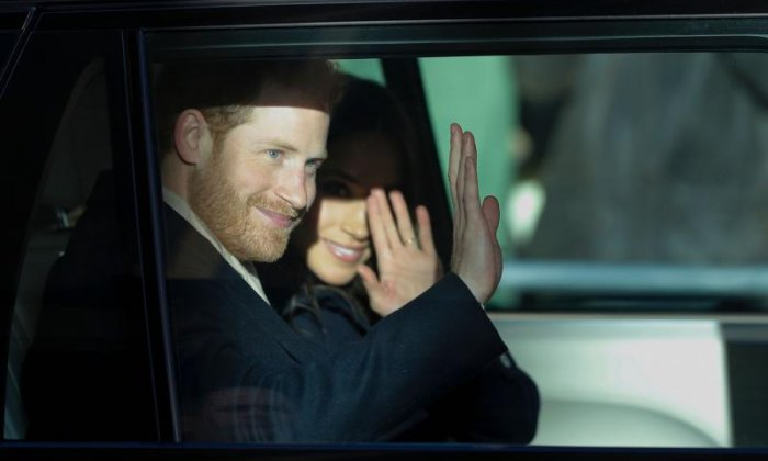 The couple are seen waving from the car
