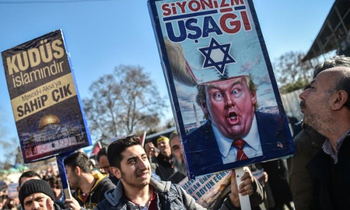 Images of Donald Trump can be seen around protests